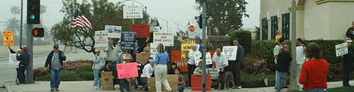 Protesters at the street corner in front of Home Depot