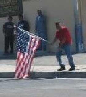Bernardo desecrates flag