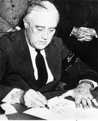 Franklin Delano Roosevelt Signs Declaration of War Against Japan